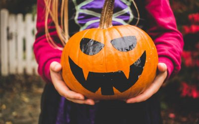 Child holding pumpkin, Bolthole Retreats